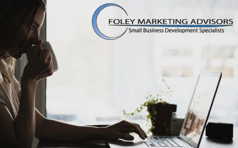 Woman typing press release for small business